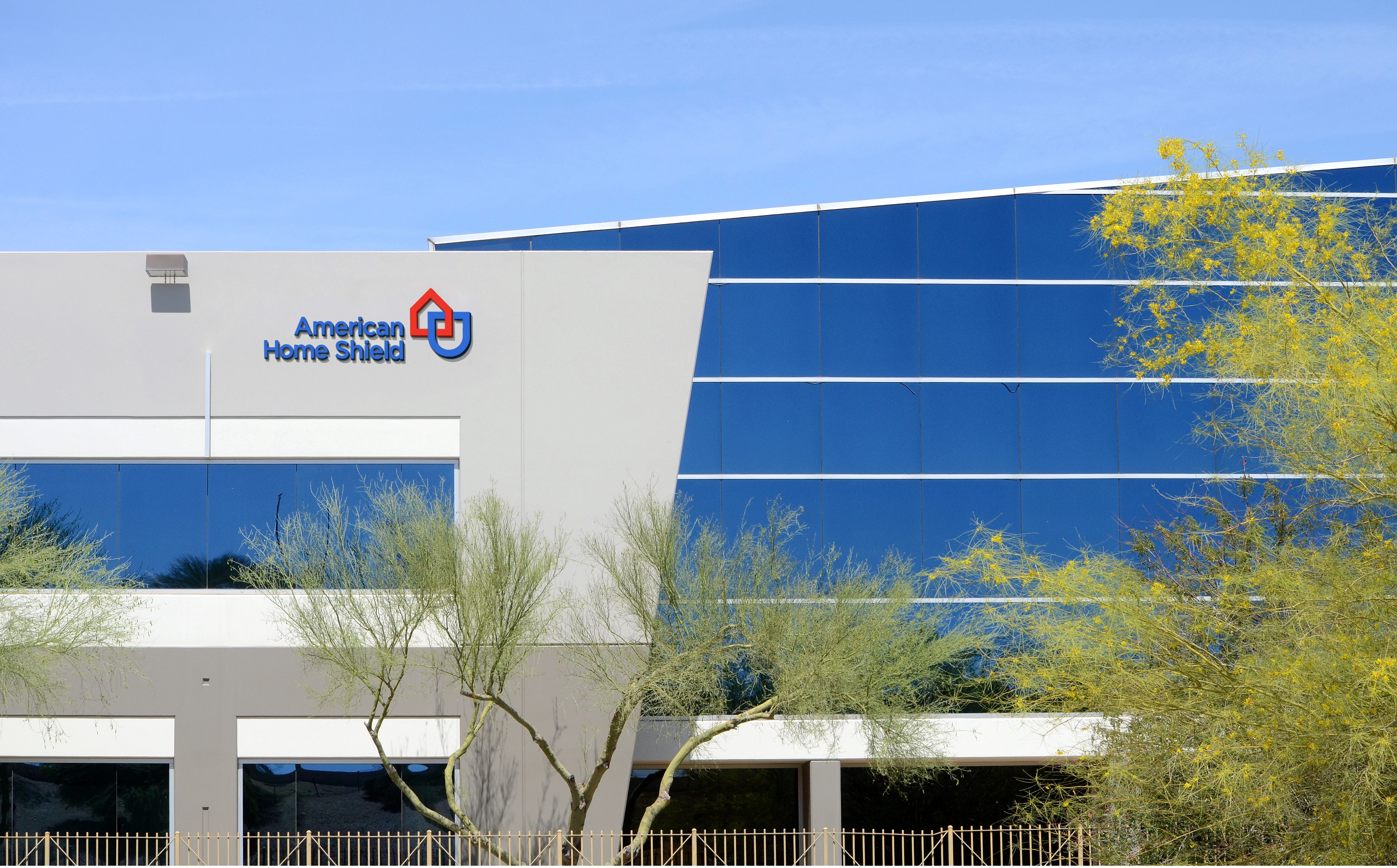 american home shield cuts ribbon on phoenix customer care center