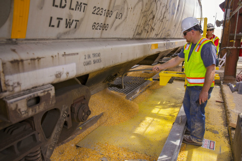 West Plains LLC employee unloads first unit train of grain (Photo: Business Wire)