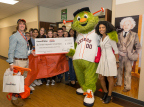 The Houston Astros mascot, Orbit, and ConocoPhillips representative Ty Johnson (right) visit Creekside Park Junior High School in Tomball ISD to congratulate Christopher Penny (left) who was named as a 2017 ConocoPhillips Math Teacher of the Month. (Photo: Business Wire)