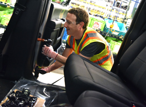 Facebook CEO Mark Zuckerberg works on the F-150 assembly line during a visit to Ford's Dearborn Truck Plant (Photo: Business Wire)