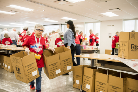 "At The Kraft Heinz Company offices in Chicago, kids and parents participated in a meal-packaging event Thursday put on by Rise Against Hunger, an international nonprofit that distributes food and aid to vulnerable populations around the world. The event was part of the company's first-ever ""Take Your Sons & Daughters To Work Day."" Packages are scheduled to arrive in Zambia where a local nonprofit partner will distribute the meals to hungry children. (Photo: Business Wire)"