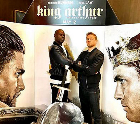 """L-r Djimon Hounsou and Charlie Hunnam stop by NYC theater for King for a Day advance screening of """"King Arthur: Legend of the Sword,"""" in theaters May 12 (Photo: Business Wire)"""