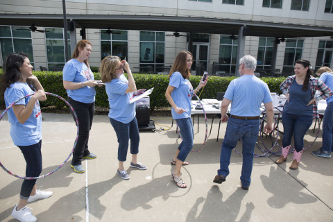 Rent-A-Center coworkers ditched their business attire in lieu of T-shirts today as part of their month-long North Texas Food Bank campaign. (Photo: Business Wire)