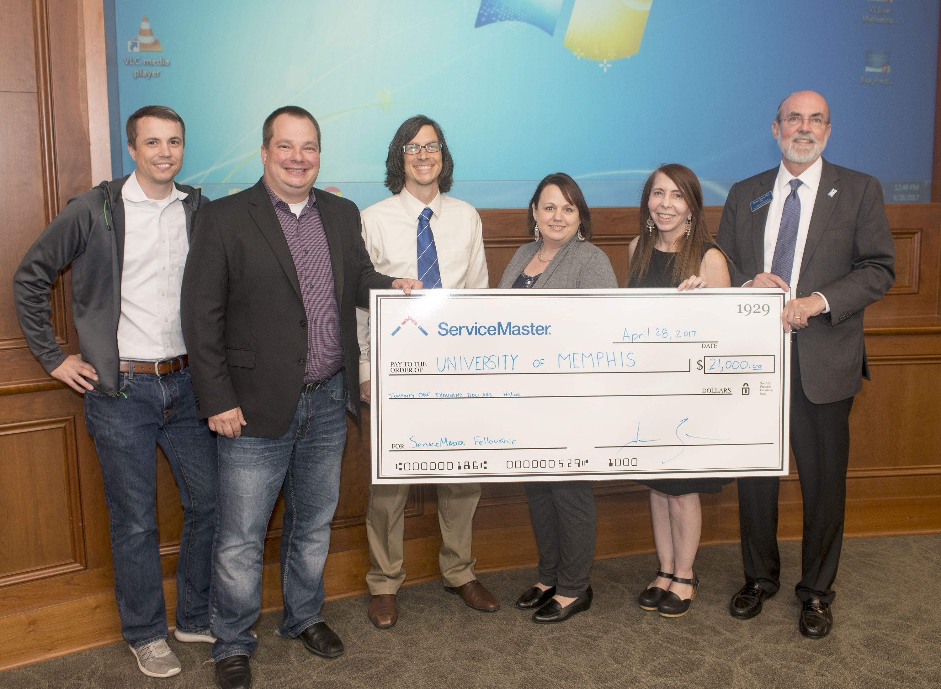Jamie Smith, CIO of ServiceMaster, and leaders from his Customer Experience team, present the first of two anthropology scholarship grants to Tom Nenon, Dean of the College of Arts & Sciences at the University of Memphis. (Photo: Business Wire)