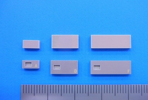 Ceramic packages with embedded RFID antenna (scale showing 1.0mm increments) (Photo: Business Wire)