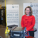 Klas Telecom Government Strategic Systems Engineer Herman Leybovich gives Congresswoman Comstock a demonstration of the new Voyager Tactical Data Center, Klas Telecom's latest product. (Photo: Business Wire)