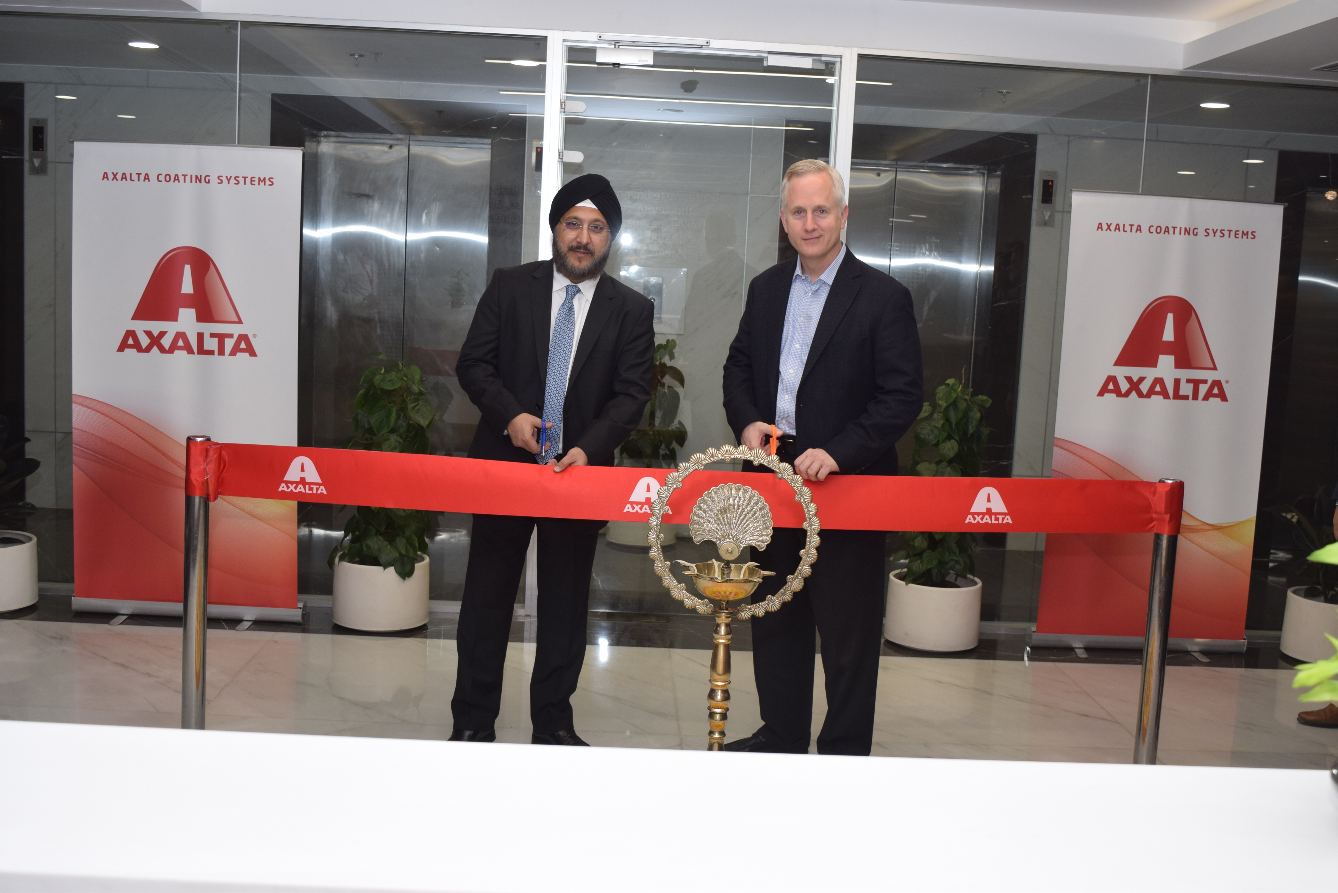 Sobers Sethi (Left), Axalta Vice President and President, Emerging Markets and Robert Bryant, Executive Vice President and Chief Financial Officer of Axalta cut ribbon at new India headquarters' opening (Photo: Axalta)