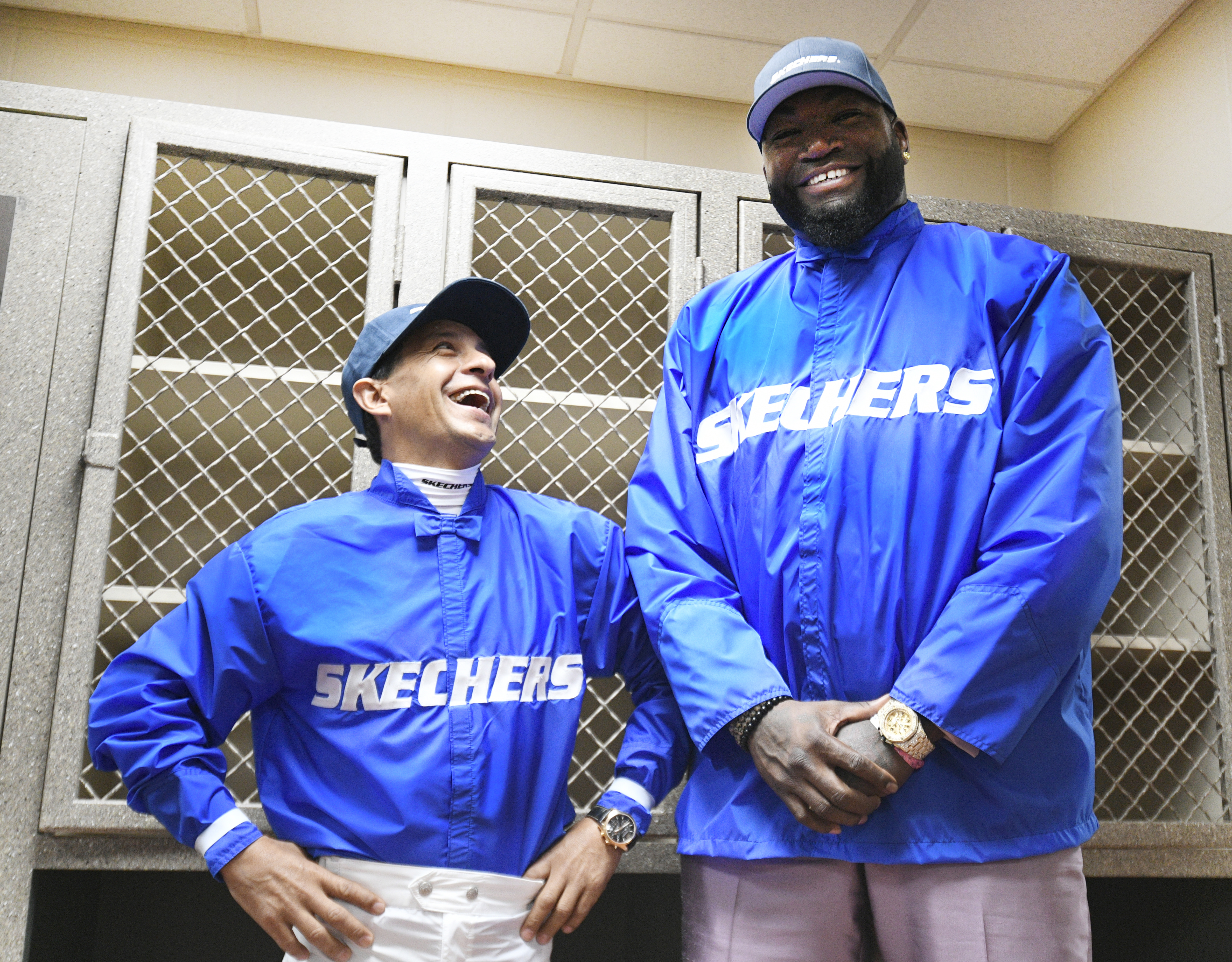 """Looks like David """"Big Papi"""" Ortiz can't hack retirement. The All-Time slugger traded in his baseball uniform for racing silks with 2015 Triple Crown-winning jockey Victor """"Little Papi"""" Espinoza in the Jockey Room at Churchill Downs. Both champions are representing SKECHERS. (Photo: Business Wire)"""