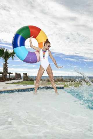 Celebrate summer and make a splash with fun, eye-catching items from Macy's. Bleu by Rod Beattie swimsuit, $109; Ray Ban sunglasses, $200; Ban.Do ring float, $24. (Photo: Business Wire)