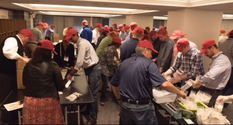 Lincoln IT Leaders Package Meals for Rise Against Hunger (Photo: Business Wire)