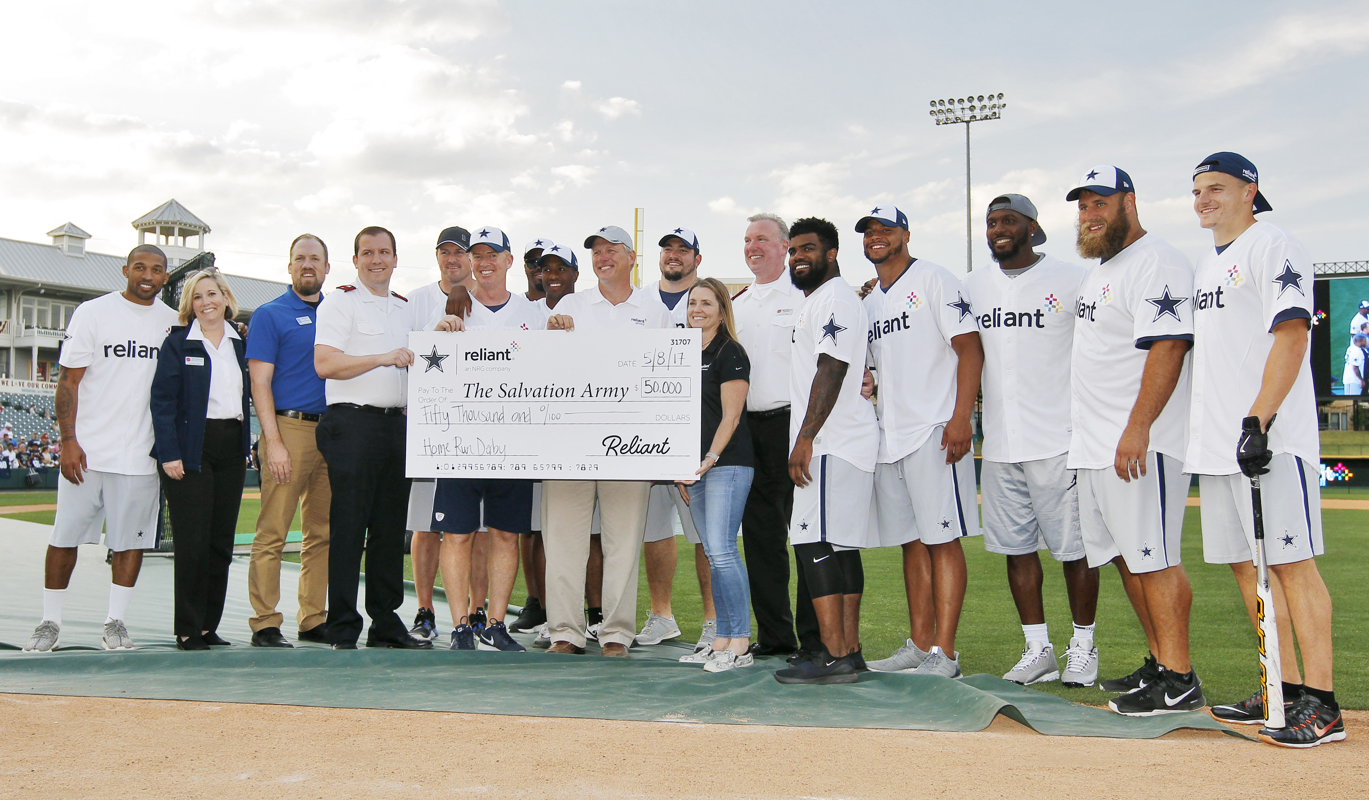 Reliant and the Dallas Cowboys present a check for $50,000 to The Salvation Army at the 2017 Reliant Home Run Derby in Frisco, Texas. (Photo: Business Wire)