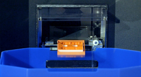 The Stratasys Continuous Build 3D Demonstrator automatically prints, ejects and commences new parts without human intervention (Photo: Business Wire)