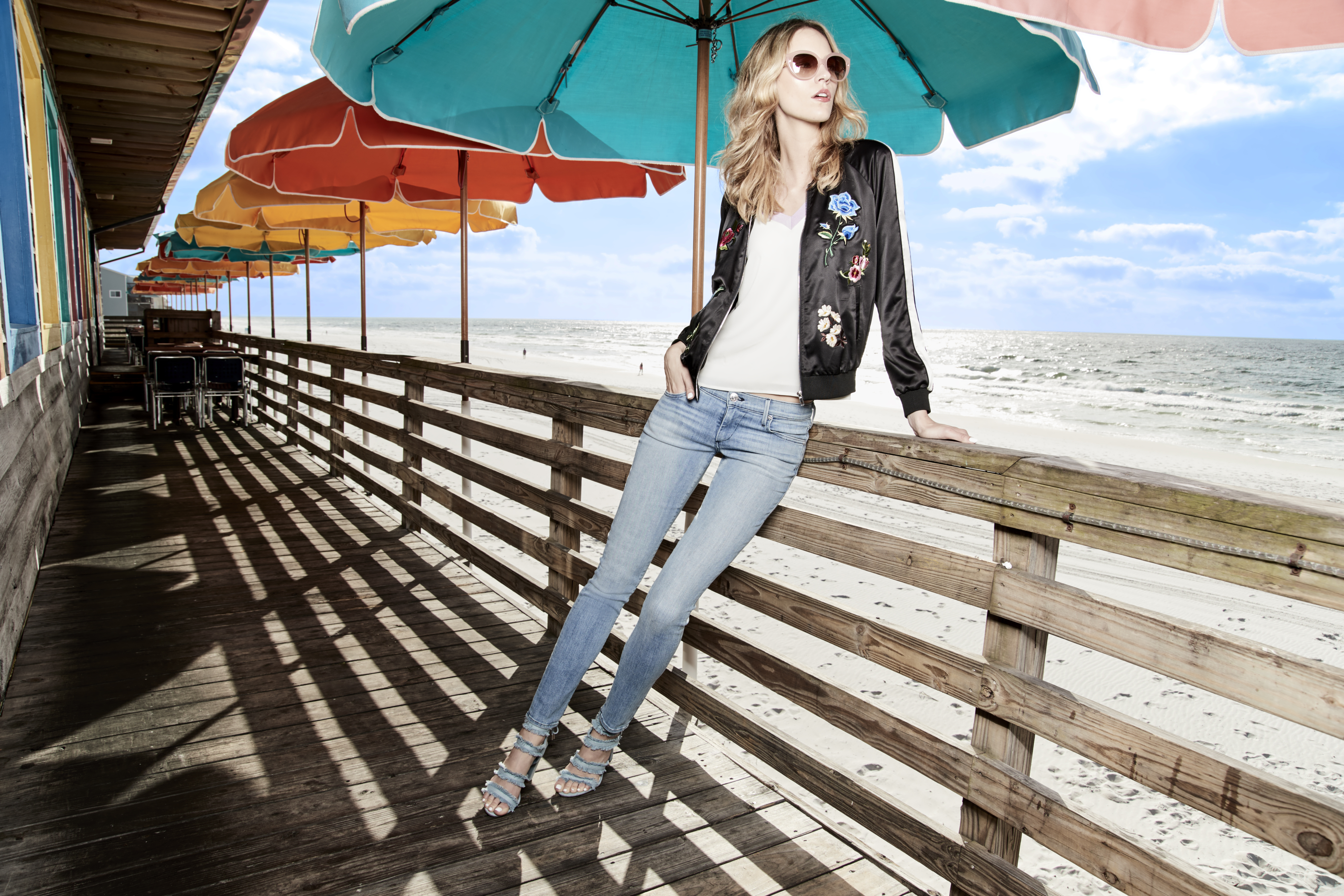 CR by Cynthia Rowley is a cheerful limited-time summer collection, available exclusively at select Macy's locations and on macys.com. Embroidered bomber jacket, $149; color blocked t-shirt, $79. (Photo: Business Wire)