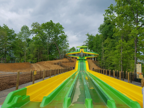 The newest attraction at Dollywood's Splash Country is TailSpin Racer—a five-story family racing complex with slides that stretch longer than a football field! (Photo: Business Wire)