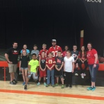 Kansas City Chiefs tight end Travis Kelce with students and teachers at Oak Grove Elementary School following a dedication ceremony for the school's recently refurbished gymnasium. UnitedHealthcare donated $20,000 to Kelce's Dreambuilders Foundation, which funded the refinishing of the gym's floor and new paint during the students' recent spring break (Photo: Garrett Kasper/UnitedHealthcare).