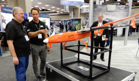 Valmie Resources President Gerald Hammack (L) and Duran De Villiers, Owner/Director of ALTI UAS, discuss the features of the ALTI aircraft purchased by Valmie and on display at XPONENTIAL. (Photo: Business Wire)