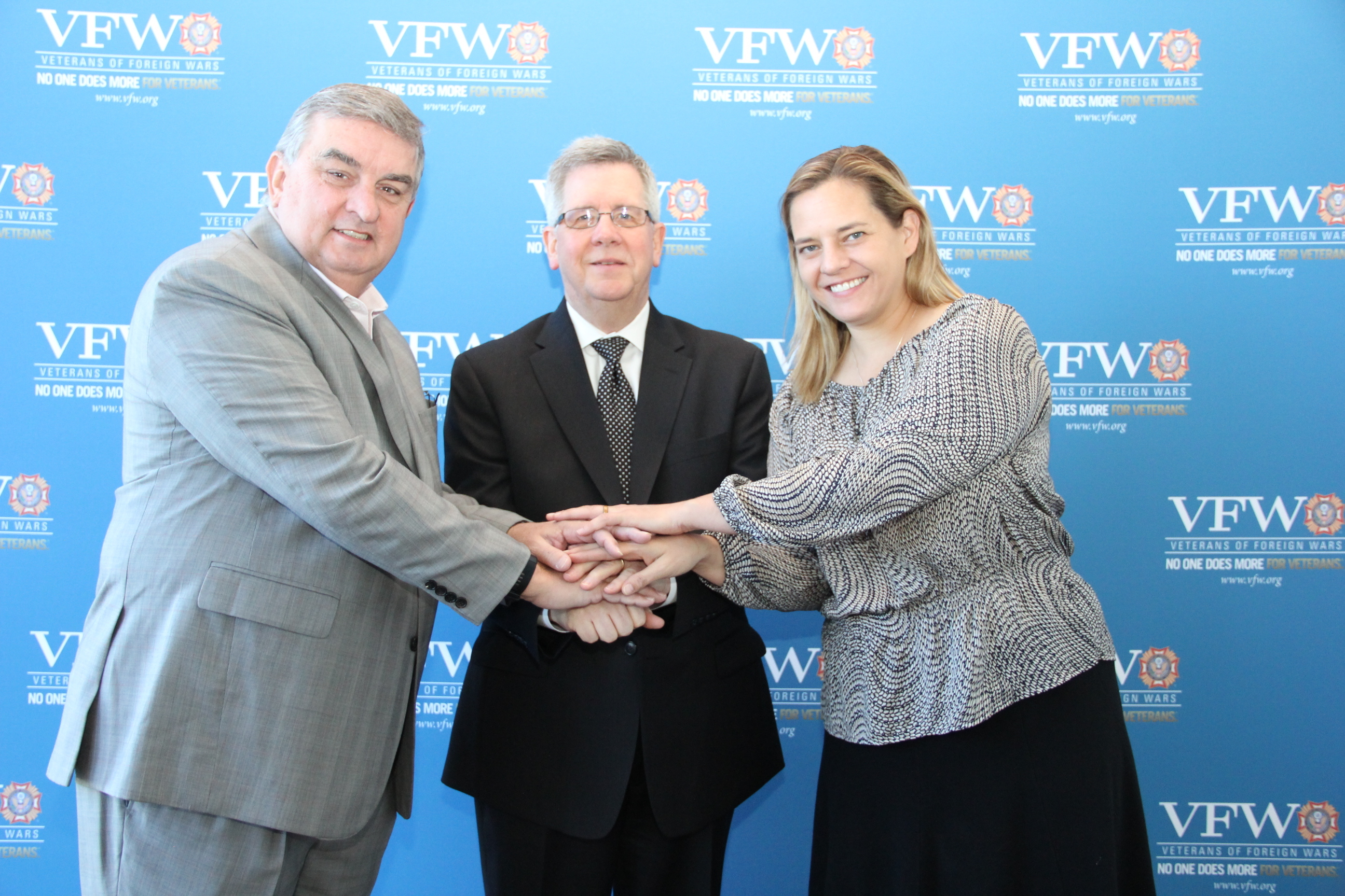Celebrating a collaborative agreement of their three organizations to help improve mental health care for Veterans are, from left, Brian Duffy, Commander-in-Chief, Veterans of Foreign Wars of the U.S.; Dr. Chet Robson, Medical Director, Clinical Programs and Quality, Walgreens; and Dr. Caitlin Thompson, Executive Director, Office of Suicide Prevention, U.S. Department of Veterans Affairs. The three announced the initiative at a national meeting of VFW officers Saturday, May 6, in Kansas City, Missouri. (Photo: Business Wire)