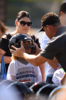 Riddell representative educates young athlete and parent on proper equipment fitting at USA Football Protection Tour. (Photo: Business Wire)