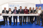 At the dedication of new Selexis laboratories and facilities, Fongit's Pierre Strubin, Swiss Biotech Association's Dr. Bettina Ernst, Selexis CEO and Chairman Dr. Igor Fisch, Conseiller d'Etat for Geneva Pierre Maudet, Selexis Co-Founder and Board Member Prof. Nicolas Mermod, Mayor of Plan-les-Ouates Fabienne Monbaron, Selexis Board Member Marcel Schmocker, Selexis Employee Dr. David Calabrese, and Selexis Board Member Dr. Peter Pfister celebrate with an official ribbon cutting. (Photo: Business Wire)