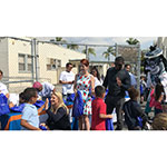 Meghan Newkirk of UnitedHealthcare, actress Megan Hayes and LaDainian Tomlinson of the Los Angeles Chargers distributed 200 backpacks to students today at Horace Mann Elementary School in Long Beach, as part of a collaboration between UnitedHealthcare, LaDainian Tomlinson's Touching Lives Foundation and Blessings in a Backpack (Video: Anita Sen).
