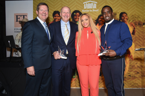 "(L-R) CEO, HPS Investment Partners, Scott Kapnick, President and Co-COO of Goldman Sachs and honoree David M. Solomon, musical artist Faith Evans and honoree Sean Combs pose on stage with awards at the Room to Read event honoring Sean ""Diddy"" Combs & David M. Solomon for Impact On Global Education at 2017 New York Gala at The Highline Hotel on May 11, 2017 in New York City. (Photo by Nicholas Hunt/Getty Images for Room To Read)"