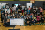 Matt Watrous, executive director of Boys & Girls Clubs Washington, was recently presented with a $40,000 check by Cindy Spain of UnitedHealthcare Community Plan to fund youth mental health programs. Many Boys & Girls Clubs of King County members participated in the event (Photo: Kim Doyel).