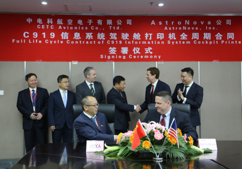Greg Woods (standing, second from right), president and CEO of AstroNova, and Chen Guohai, general m ...