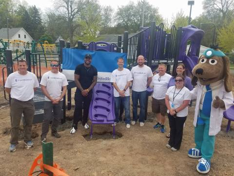 Jayrone Elliott, Green Bay Packers linebacker, was joined by employee volunteers from UnitedHealthcare today at Lincoln Elementary School in Green Bay. UnitedHealthcare donated $27,000 to Elliott's Dreambuilders program that was used to install a new playground by the UnitedHealthcare volunteers on Monday (Photo courtesy of UnitedHealthcare).