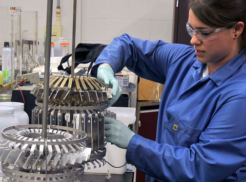 Marissa Menanno, Staff Technician at the Arconic Technology Center, prepares parts for chemical surface treatment. (Photo: Business Wire)