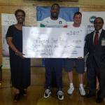 Redona Williams, Townsend Elementary School principal; Jayrone Elliott, Green Bay Packers linebacker; Dustin Hinton, CEO and president, UnitedHealthcare of Wisconsin; and Dr. Reginald Lawrence II, regional superintendent, Milwaukee Public Schools, announced UnitedHealthcare's $11,000 donation to Elliott's Dreambuilders program at Townsend Street School in Milwaukee. The donation will be used to fund Blessings in a Backpack, a national nonprofit that provides students with bags of nutritious food each weekend (Photo courtesy of UnitedHealthcare).