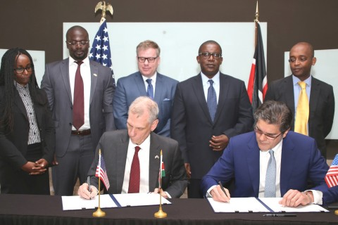 U.S. Ambassador to Kenya, Robert F. Godec, signs the grants on behalf of USTDA, along with Xago Afri ...
