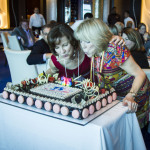 Joyce Landry & Jo Kling with a festive cake from Celebrity Cruises at their 35th Anniversary Event on Celebrity Reflection. (Photo: Business Wire)