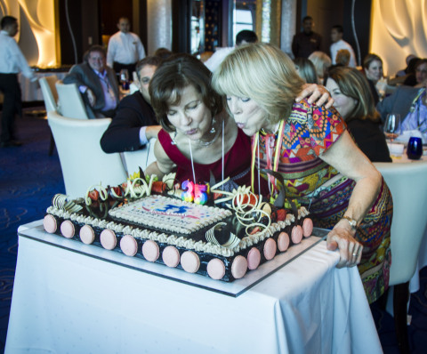 Joyce Landry & Jo Kling with a festive cake from Celebrity Cruises at their 35th Anniversary Event o ...