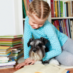 According to the Human Animal Bond Research Institute (HABRI), classroom and therapy pets can motivate children to improve their reading performance. Now, pets and their pet parents can prepare for Therapy Dog evaluation through PetSmart's newly offered six-week Dog Therapy Training Course – a first for a national pet retailer to offer this unique pet training program. Once certified, the pet parents and their dogs can give back to the community through the emotional support of a Therapy Dog at schools, libraries, hospitals and senior living facilities, among others. (Photo: Business Wire)