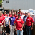 Mark and Adam Warsofsky from M&M Transport Services, Inc. provided logistical support to deliver backpacks to the schools, are joined by Staples' Supply Chain associates and Lynn Margherio, Cradles to Crayons' Founder and CEO. (Photo: Business Wire)