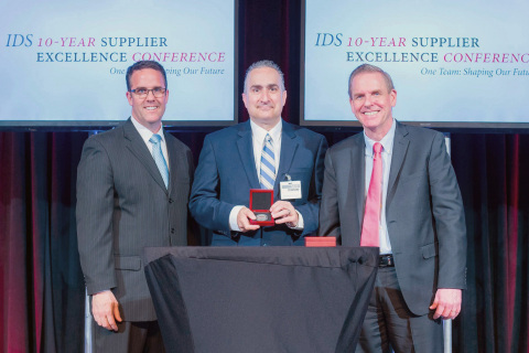 David Pearson, President of LCR Embedded Systems, at center accepting award from John Bergeron (left) and Michael Shaughnessy (right) of Raytheon. (Photo: Business Wire)