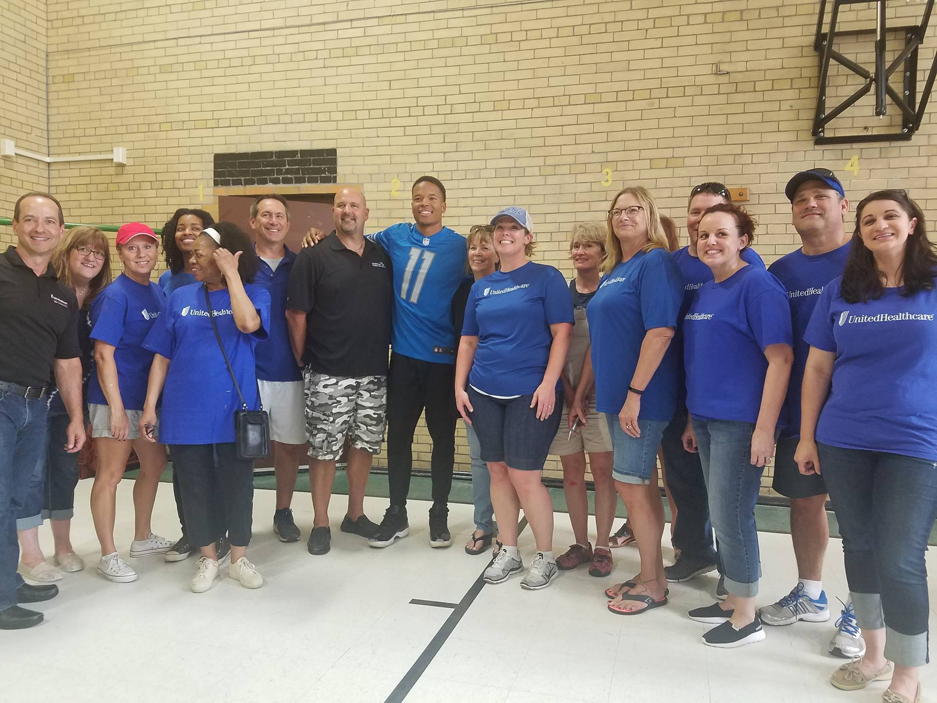 UnitedHealthcare volunteers on Thursday visited J.E. Clark Preparatory Academy in Detroit and painted a series of panel murals for the gym's walls. At the school, the volunteers were joined by Detroit Lions wide receiver Marvin Jones Jr. and officials from City Year Detroit to announce UnitedHealthcare's $11,000 donation to Jones' Dreambuilders program. The donation was used to purchase four new basketball backboards and paint the gym's lockers (Photo courtesy of UnitedHealthcare).