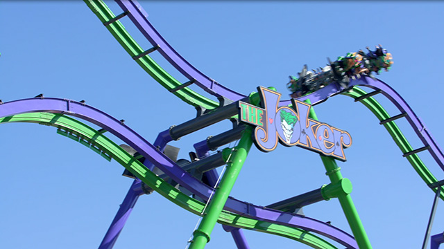 THE JOKER at Six Flags Over Texas is a 12-story, freestyle-coaster with a 90-degree hill that flips riders head-over-heels at least six times as they travel through a thrilling and weightless journey.