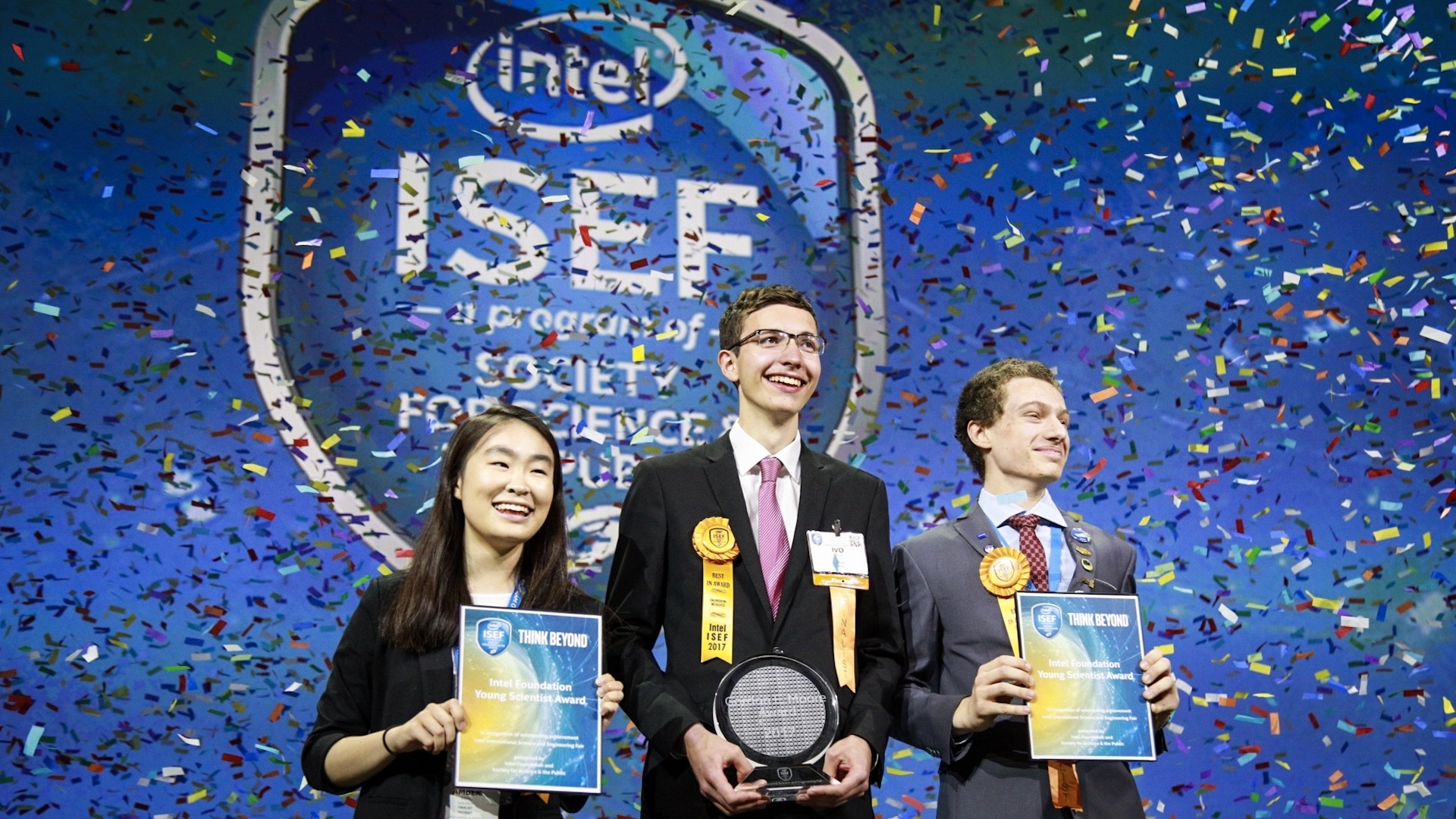 """Amber Yang (from left), Ivo Zell and Valerio Pagliarino take the stage on Friday, May 19, 2017, at the 2017 International Science and Engineering Fair, a program of Society for Science & the Public and the world's largest international pre-college science competition. Zell, of Lorch, Germany, was awarded first place for designing and constructing a remote control prototype of a new """"flying wing"""" aircraft. Yang, of Windermere, Florida, and Pagliarino, of Castelnuovo Calcea, Italy, received Intel Foundation Young Scientist Awards. (Credit: The Society for Science & the Public)"""