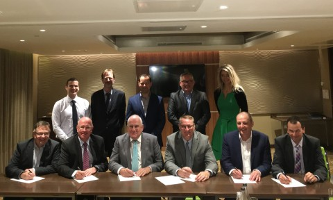 Front row: Phil Buck, Spencer Coatings Group Managing Director (third from left) and Michael Cash, Axalta SVP and President, Industrial Coatings (fourth from left) with other Spencer Coatings Group shareholders, Axalta executives, and guests. (Photo: Axalta)