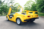 This Fly Yellow '88 Lamborghini Countach 5000 Quattrovalvole that was built for legendary engineering technician and collector Joe Nastasi, and is signed by Lamborghini legend Valentino Balboni, will cross the Barrett-Jackson Northeast Auction block (Photo: Business Wire)