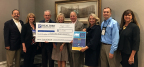 Members of the Northwest Federal Board of Directors and Northwest Federal employees presented the check to representatives from the REALTORS® Relief Foundation (Photo: Business Wire)