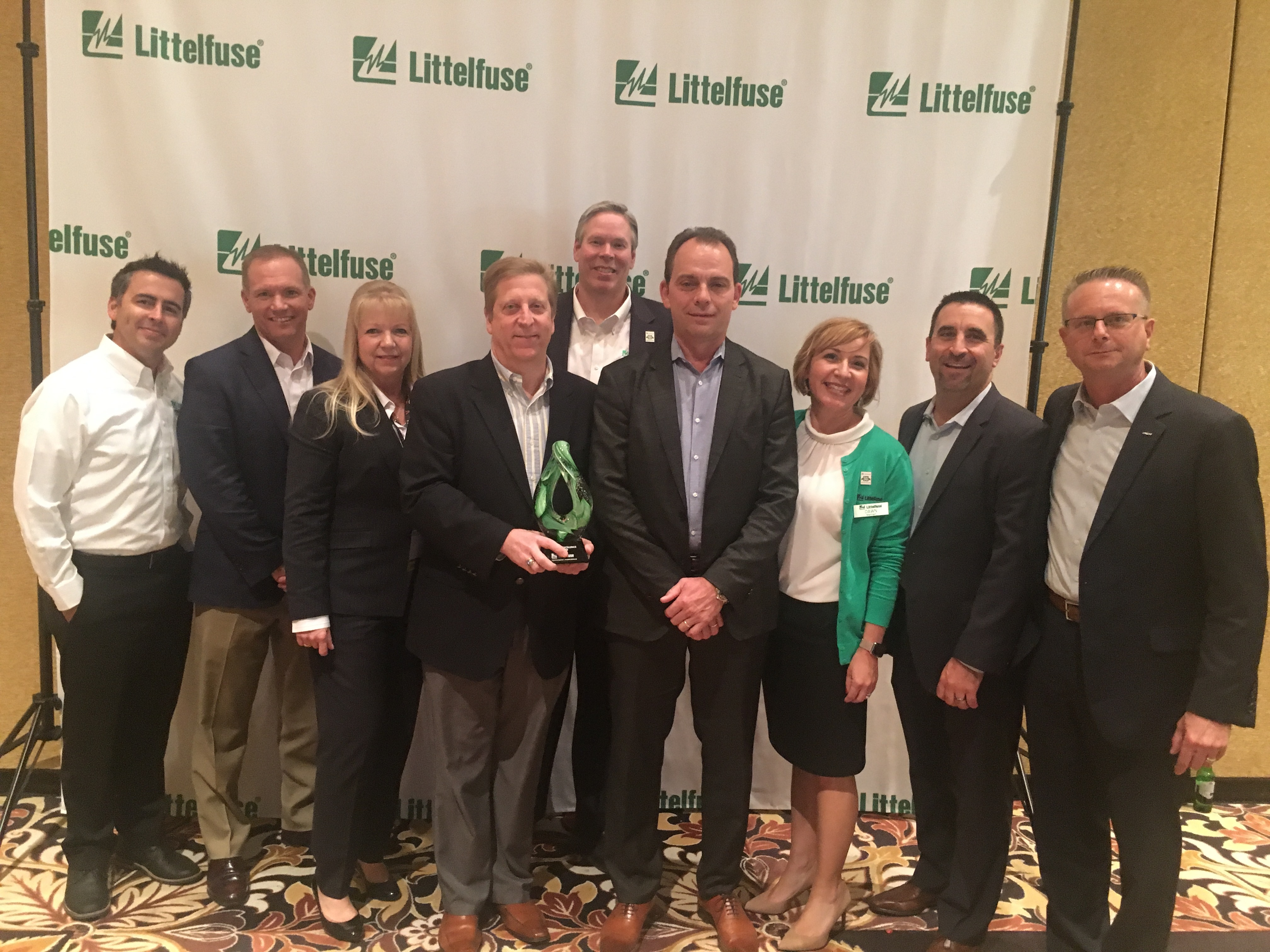 Littelfuse congratulates Arrow Electronics on winning the 2016 Volume Distributor of the Year award. Pictured (from left to right): Jason Lipps, Littelfuse distribution corporate account manager; John Drabik, Arrow VP & GM global PEMCO; Linda Rogers, Arrow corporate supplier manager; Alan Bird, Arrow president Americas; Dave Heinzmann, Littelfuse president and chief executive officer; Bruce Jones, Arrow VP PEMCO Americas; Dawn Manhart, Littelfuse director channel sales; Vince Pastor, Arrow director; passive business unit; Kent Smith, Arrow VP North American sales. (Photo: Business Wire)