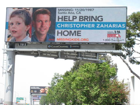 Christopher Zaharias, missing since 1987, now has a digital billboard to help in the National Missing Children's Day effort to bring him home. (Photo: Business Wire)
