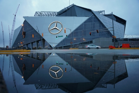 The iconic three-pointed star, measuring 66' wide, lights up for the first time during an inaugural lighting ceremony at Mercedes-Benz Stadium on Thursday, May 25, 2017 in Atlanta, GA. (Jason Hales/Mercedes-Benz)