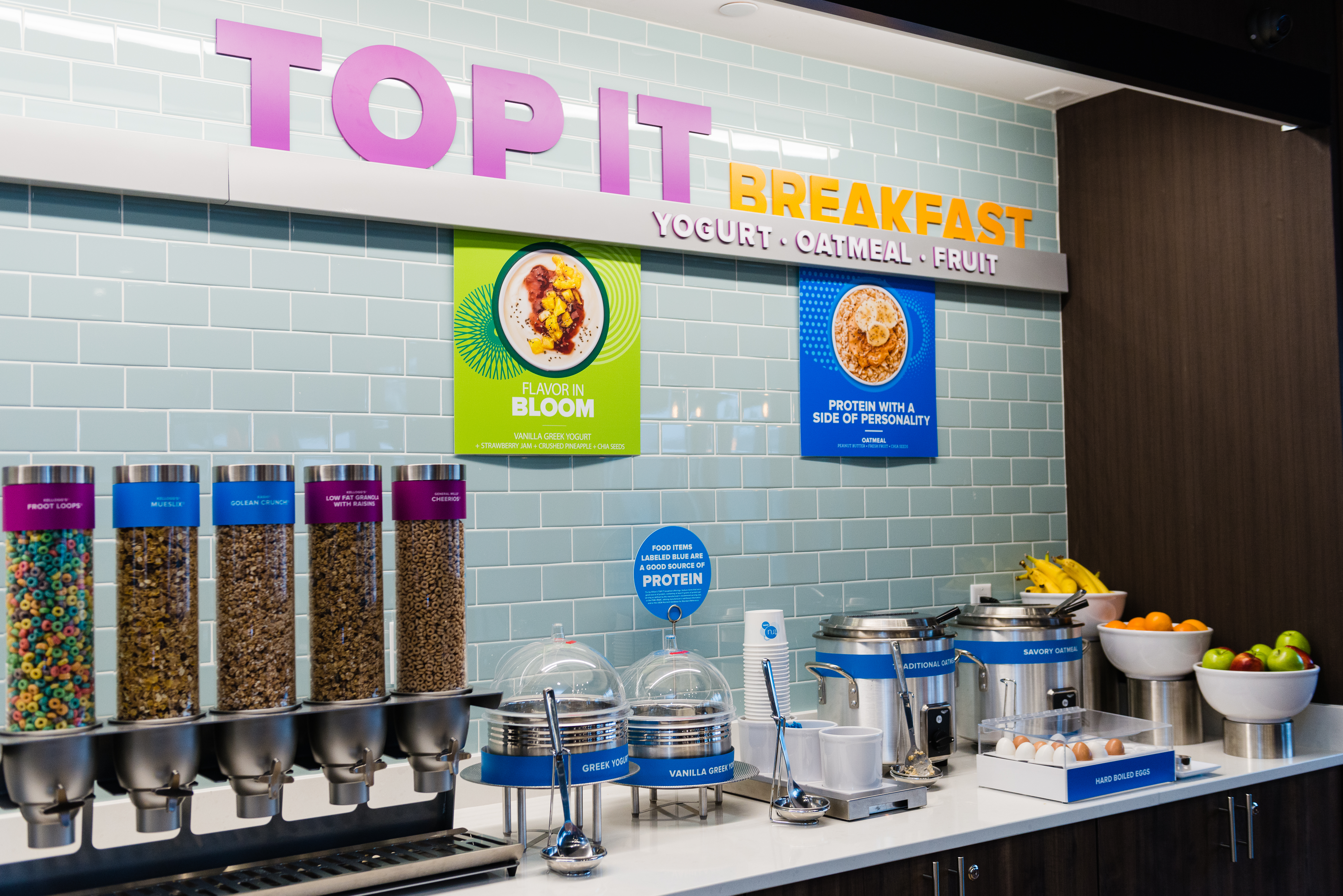 """Breakfast is reinvented with the build-your-own complimentary """"Top It"""" breakfast bar that has 30 sweet and savory toppings so guests can create their own healthy or indulgent morning masterpieces. (Photo: Business Wire)"""