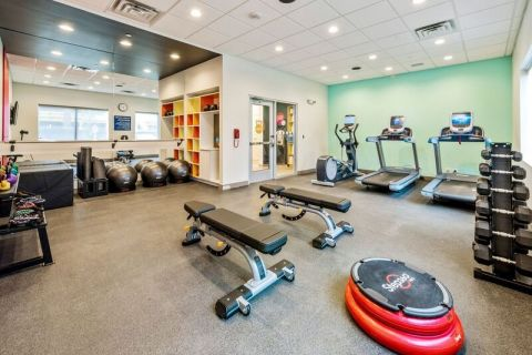 A fitness center that leverages the latest fitness trends through barre, TRX bands, free weights, cardio and flexibility gear, plus guests can get workout ideas from the fitness center tablet. (Photo: Business Wire)