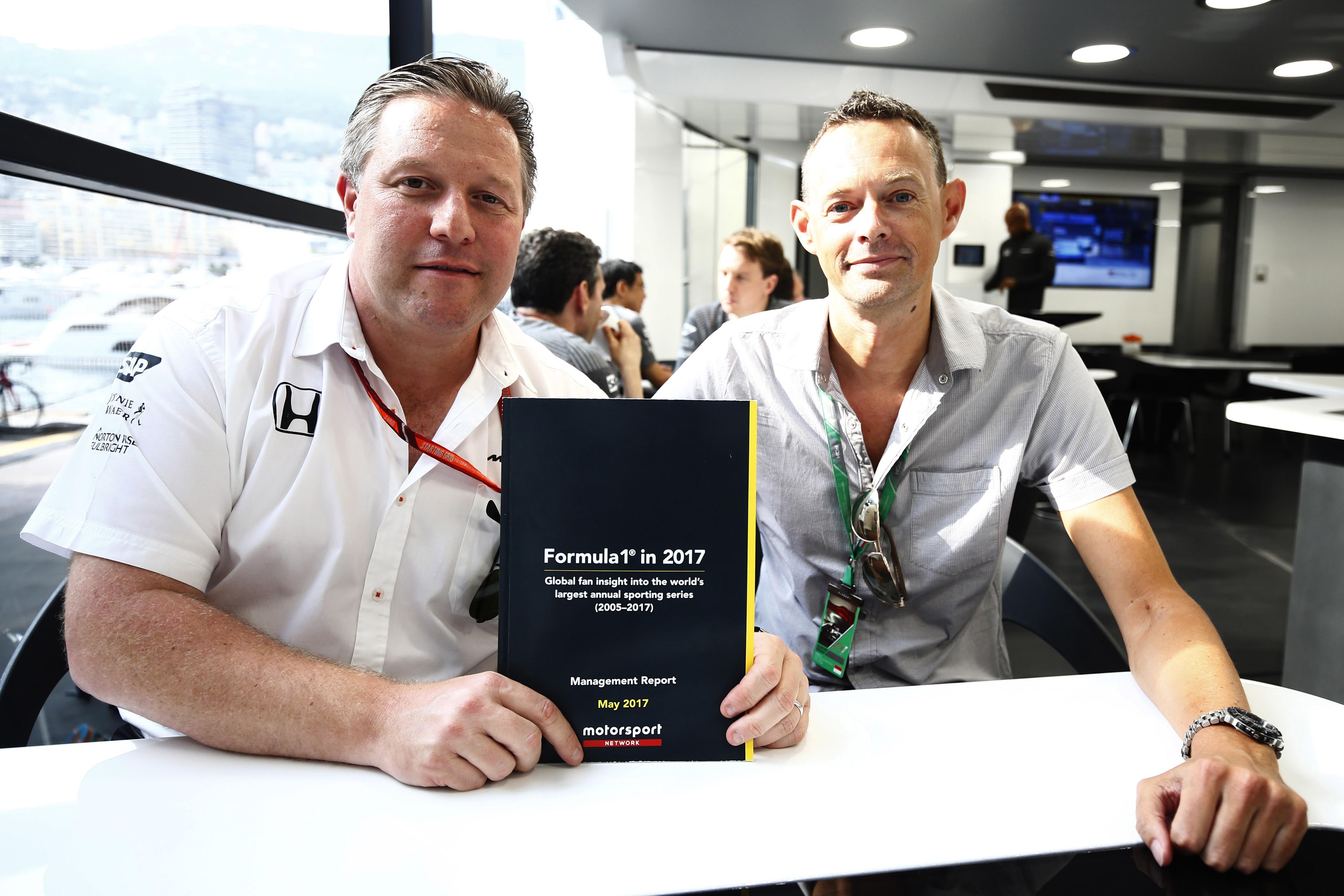 Motorsport Network Chairman Zak Brown and Editor-in-chief Charles Bradley with the results from the Motorsport Network 2017 Formula 1 fan survey. (Photo: Business Wire)