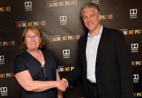 At the 2017 Cannes Film Festival, Martine Odillard, Chairman of Les Cinémas Gaumont Pathé and Doug Darrow, SVP, Cinema Business Group, Dolby Laboratories, commemorate Dolby and Pathé's collaboration to open 10 Dolby Cinema locations throughout France and the Netherlands. (Photo: Business Wire)