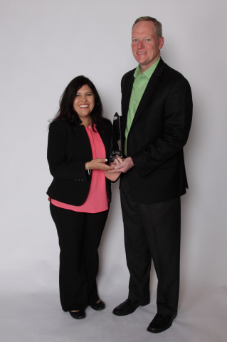 Josephina Washington from the Rincon del Diablo Municipal Water District, California, accepts the award from Tyler's Dane Womble. (Photo: Business Wire)